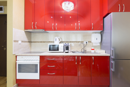 red kitchen: Kitchen in a small modern apartment