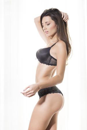 Beautiful woman posing in bra and panties