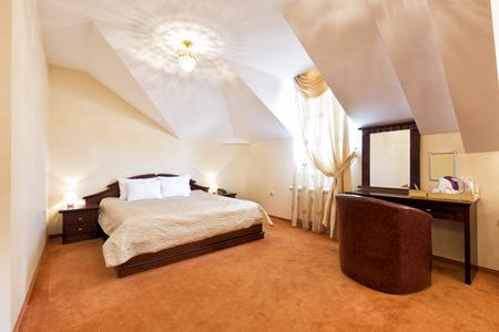 Inteiror of an elegant hotel bedroom