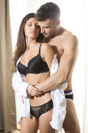sexy panties: Attractive couple in embrace