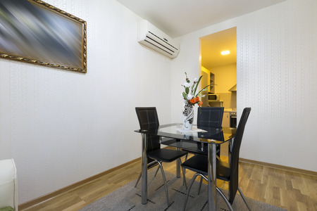dining table and chairs: Small dining table and chairs in an apartment