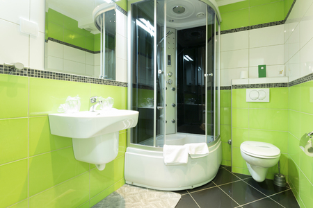 bathroom: Interior of a modern bathroom with green walls Stock Photo