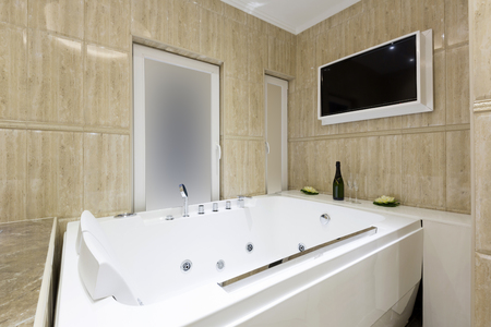 hydromassage: Hot tub and tv screen in luxury bathroom