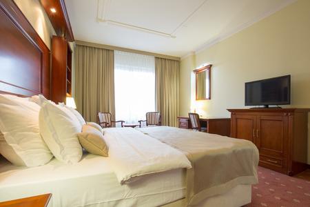 hotel: Elegant hotel bedroom interior