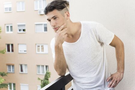 undercut: Handsome young man on the balcony