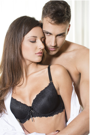 undressing woman: Attractive couple in embrace