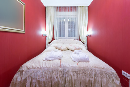 tacky: Interior of a bedroom with red walls