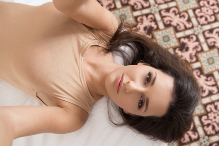 underwear: Beautiful young woman taking selfie in bed Stock Photo