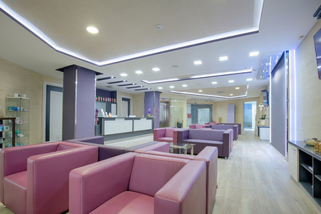 modern architecture: Spacious waiting room in a modern clinic