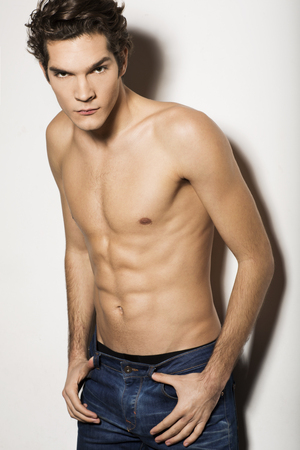 male model torso: Handsome shirtless man in jeans Stock Photo