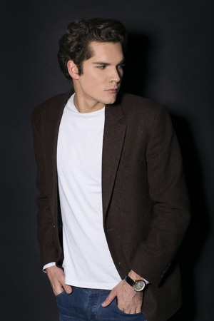 handsome guy: Portrait of a handsome man on dark background Stock Photo
