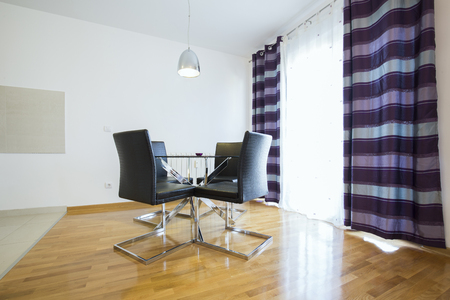 dining table and chairs: Dining table and chairs in modern apartment