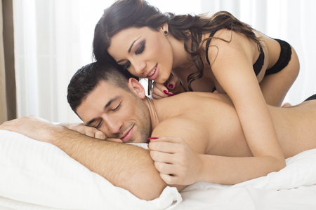 love couple: Attractive couple in bed Stock Photo
