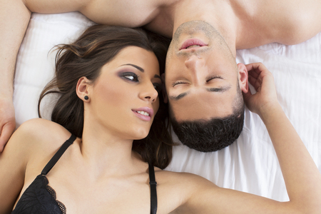 sexy woman on bed: Attractive couple in bed Stock Photo