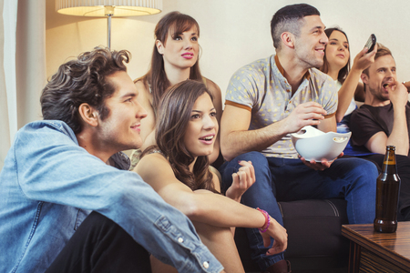 college dorm: Group of friends watching TV at home