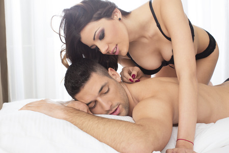 sexual foreplay: Attractive couple in bed Stock Photo