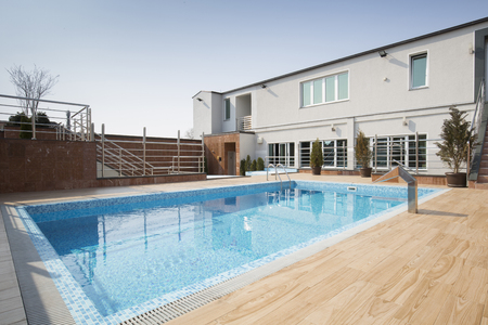 Outdoors swimming pool in front of building Stock Photo