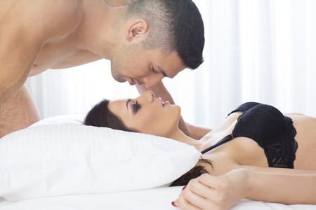 charming woman: Attractive couple in bed Stock Photo