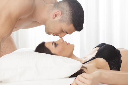 sensual woman: Attractive couple in bed Stock Photo