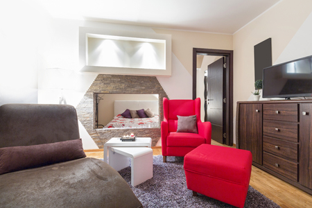 view of an elegant red couch: Interior of a modern living room interior in hotel apartment