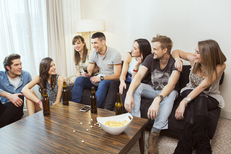 college dorm: Group of friends hanging out at home Stock Photo