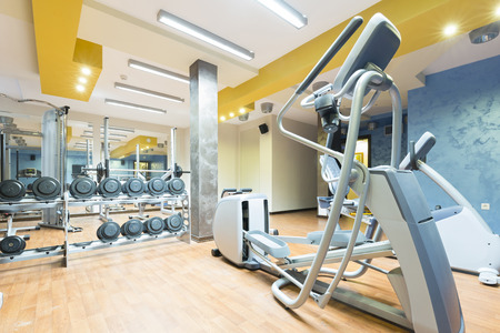 heavy equipment: Hotel gym interior with equipment Stock Photo