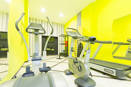heavy heart: Small gym interior with equipment