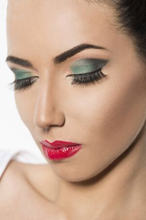 green eye: Beauty portrait with red lipstick and green eye shadow Stock Photo