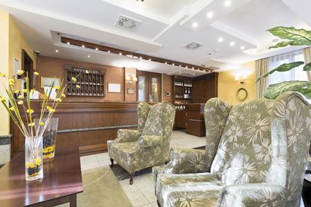 desk area: Reception area with wooden reception desk