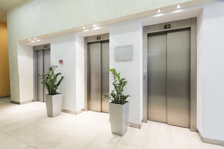 elevator: Three elevators in hotel lobby Stock Photo