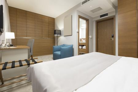 luxury bedroom: Luxury hotel bedroom in the evening Stock Photo