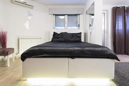 luxury bedroom: Interior of a luxury modern bedroom Stock Photo