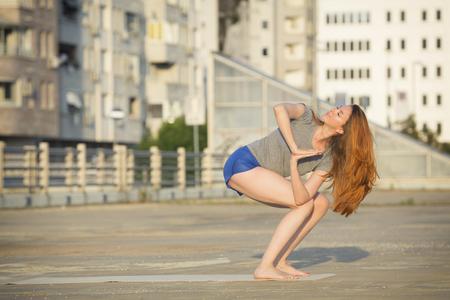 urban environment: Woman doing yoga in urban environment