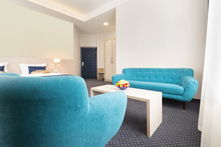 bluer: Blue sofa and armchair in hotel room Stock Photo