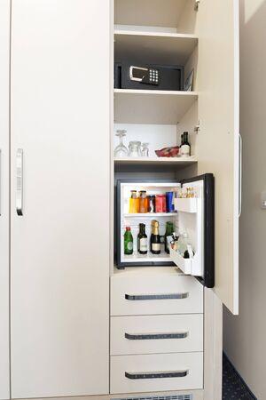 Hotel room interior with mini bar and safe box Stockfoto