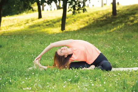 janu: Beautiful woman doing yoga outdoors