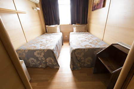 stateroom: Interior of a cabin bedroom on cruise boat hotel