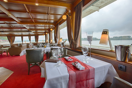 dinner cruise: Interior of a cruise boat restaurant Stock Photo