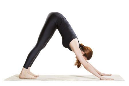 downward: Yoga Downward Facing Dog Pose - Adho Mukha Svanasana Stock Photo