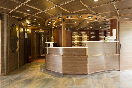 desk area: Reception area with reception desk on boat hotel Stock Photo