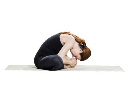 baddha: Yoga Bound Angle Forward Bend - Baddha Konasana Stock Photo