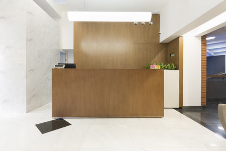 reception table: Reception area with wooden reception table Stock Photo