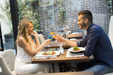 Beautiful couple on a date in restaurant