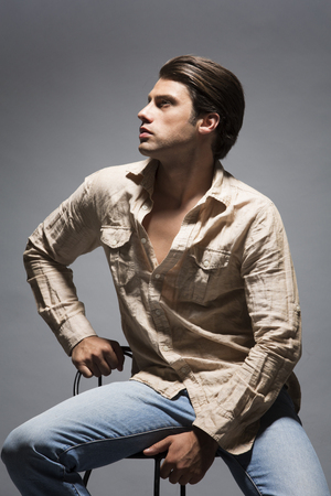 bar stool chair: Handsome man in shirt and jeans