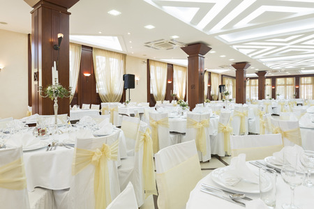 entertaining area: Wedding hall or other function facility set for fine dining Stock Photo