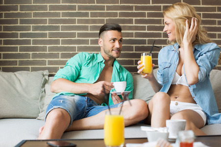 seminude: Young attractive couple relaxing at home Stock Photo