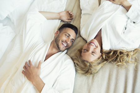 Beautiful young couple in bed Banco de Imagens - 60615369
