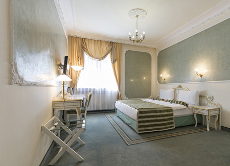 bedside lamps: Interior of a classic style bedroom in luxury hotel