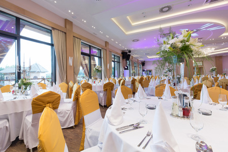 entertaining area: Wedding hall or other function facility set for fine dining