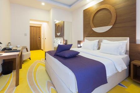 luxury bedroom: Interior of a luxury hotel bedroom Stock Photo